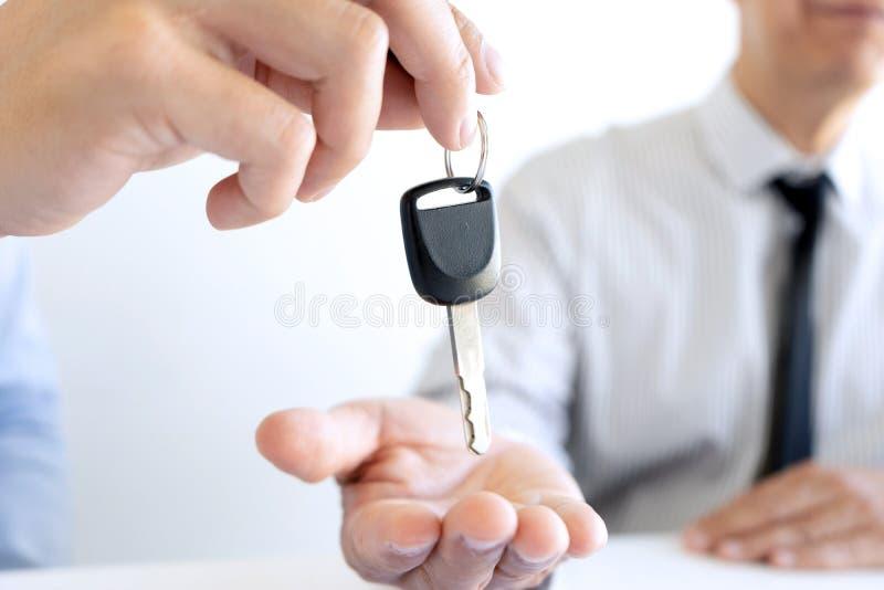 Salesman send key to customer royalty free stock image