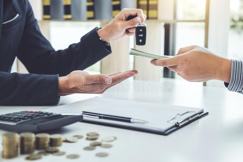 Salesman send key to customer after good deal agreement and receive money, successful car loan contract buying or selling new. Vehicle stock photography