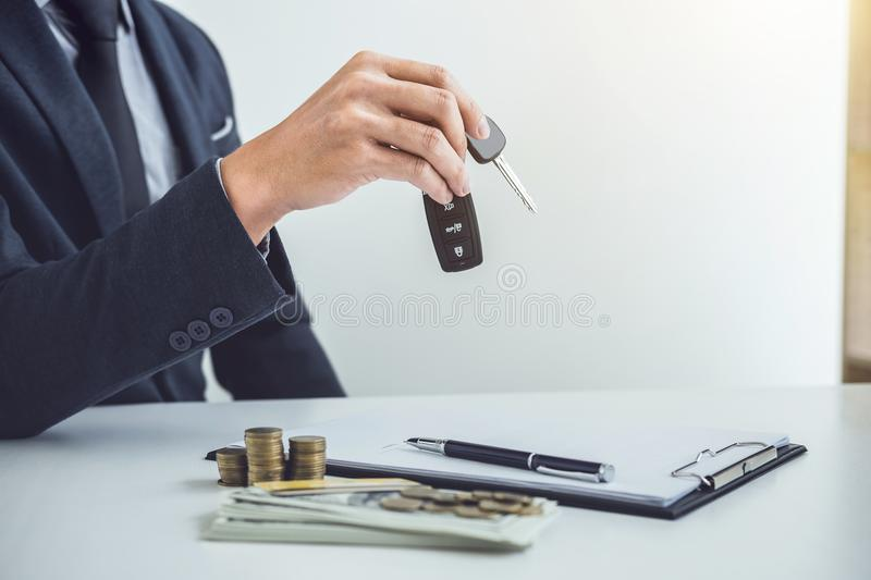 Salesman send key to customer after good deal agreement, success. Ful car loan contract buying or selling new vehicle stock images