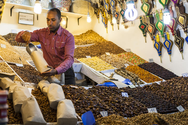 A salesman in Souk market of Marrakech, Morocco royalty free stock images
