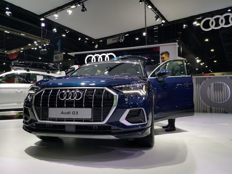 A salesman stands next to an Audi Q3 royalty free stock image