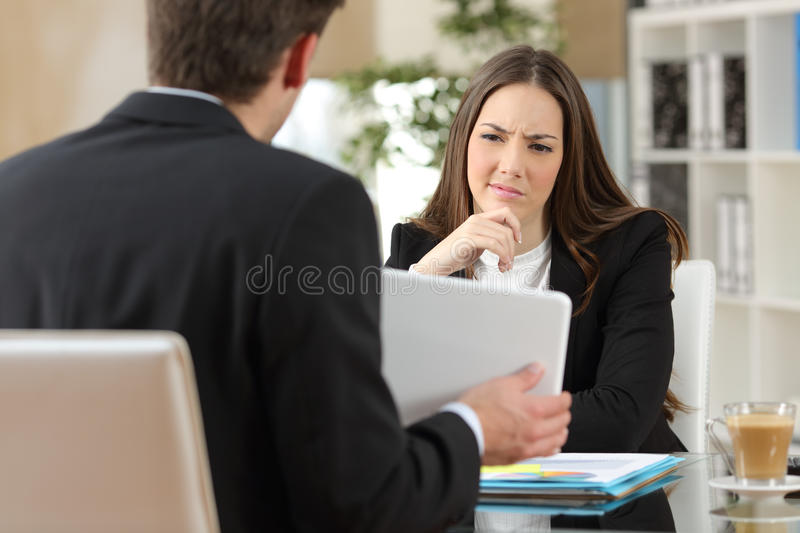 Salesman trying to convince a doubtful customer royalty free stock image