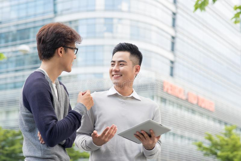 Salesman trying to sell products to a client showing them in a t royalty free stock photography