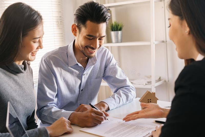 Salesmen are letting the male customers sign the sales contract, Asian women and couple are doing business in the office, Business royalty free stock photography