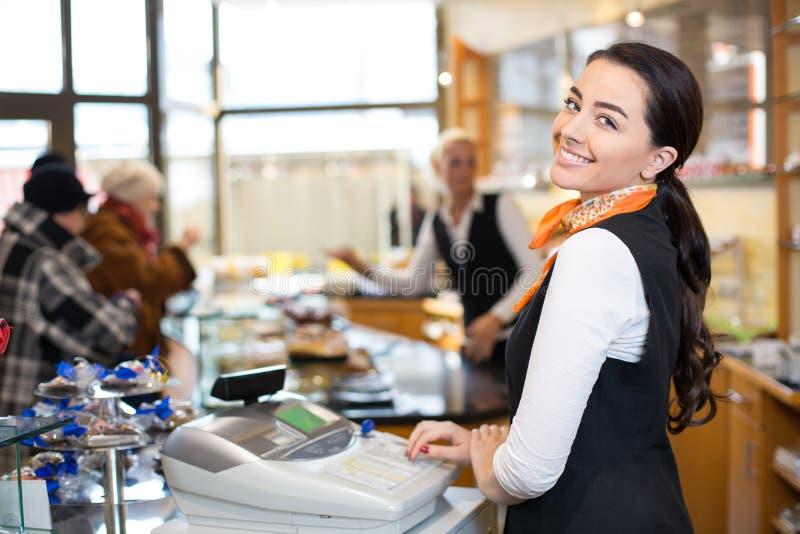 Salesperson at cash register royalty free stock images