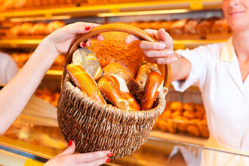 Download Salesperson With Female Customer In Bakery Stock Photo - Image: 28438672
