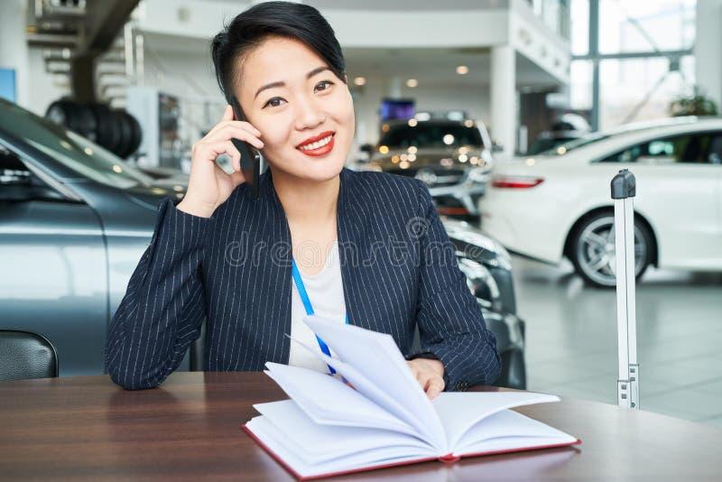 Saleswoman at auto salon royalty free stock images