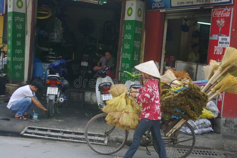 Saleswoman of Broom stock image