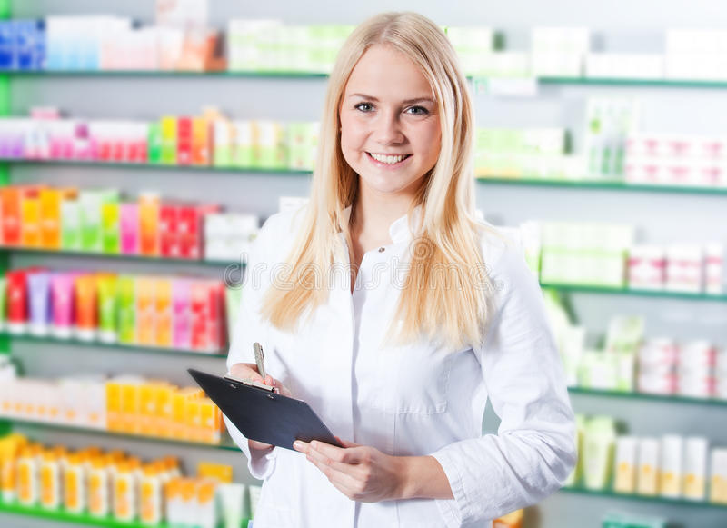 Saleswoman in chemistry royalty free stock photography