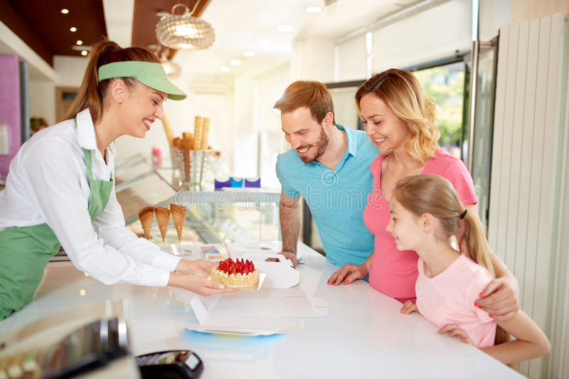 Saleswoman packing fruit cake for family stock photo