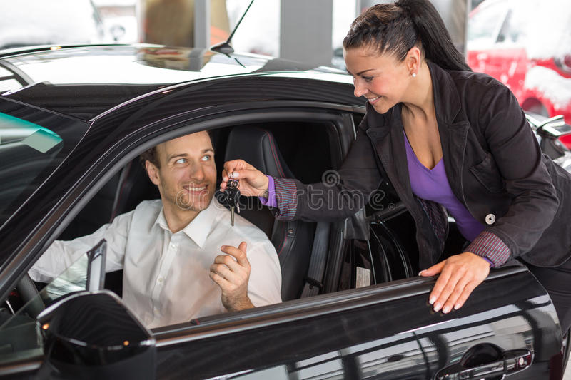 saleswoman selling a car to happy customer stock image image of deal dealership 30483467. Black Bedroom Furniture Sets. Home Design Ideas