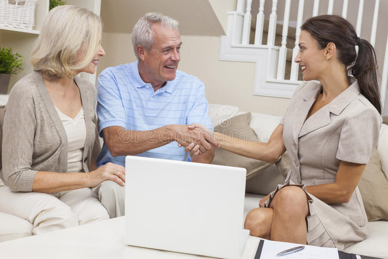 Saleswoman Shaking Hands With Senior Couple Stock Photos