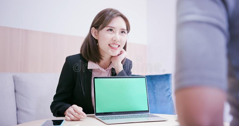 Saleswoman show green screen stock photography