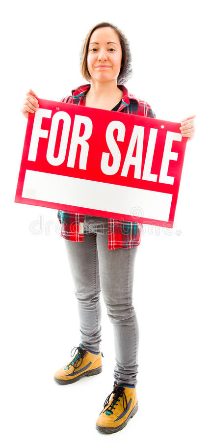 Saleswoman showing a for sale sign. Caucasian young adult woman in studio isolated on white background stock image