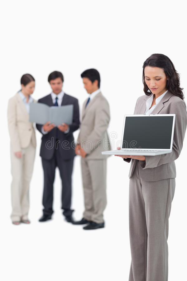 Saleswoman Showing The Screen Of Her Notebook Royalty Free Stock Image