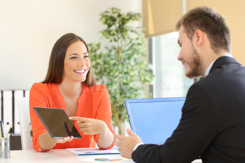 Saleswoman trying to sell to a client stock images