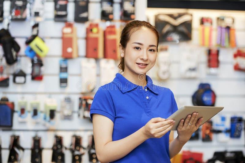 Saleswoman using digital tablet royalty free stock photography