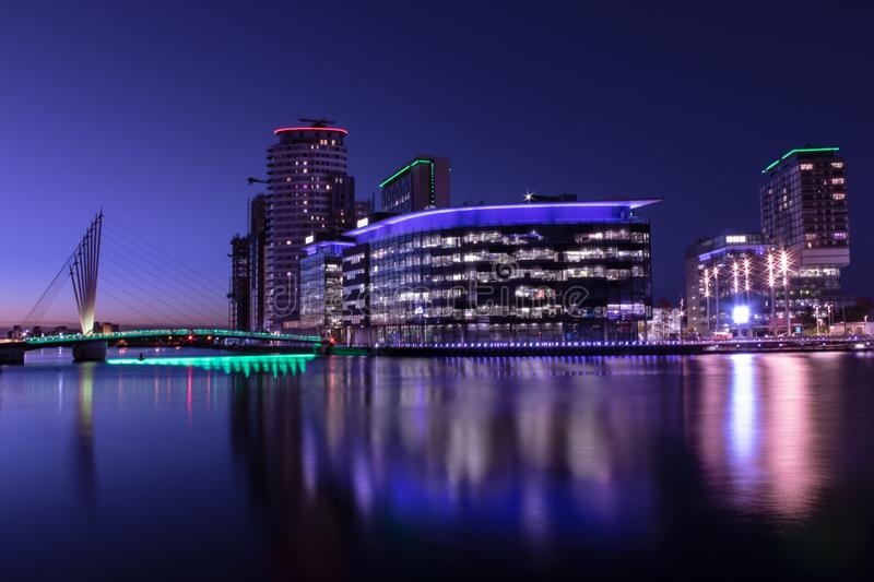 Salford Quays, England, UK, October 9, 2018 A Night time landscape using long exposure of Media City UK showing reflections on th. E Manchester Ship Canal at royalty free stock photography