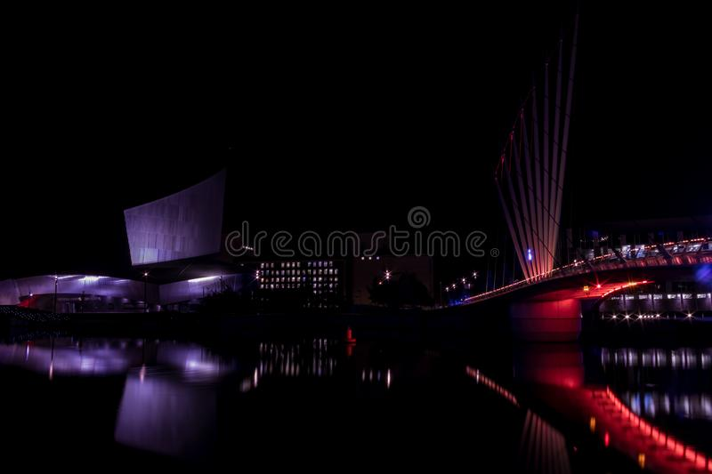 Salford Quays, England, UK, October 9, 2018 A Night time landscape using long exposure of Media City UK showing reflections on th. E Manchester Ship Canal at stock photos