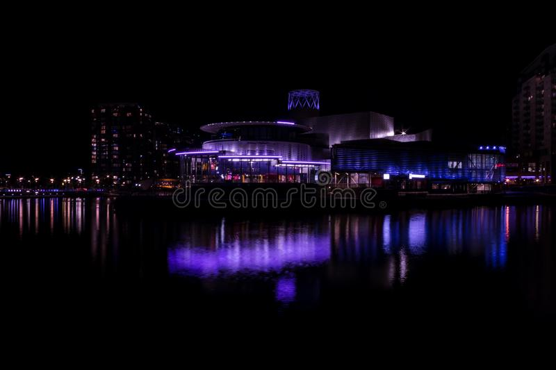 Salford Quays, England, UK, October 9, 2018 A Night time landscape using long exposure of Media City UK showing reflections on th. E Manchester Ship Canal at royalty free stock photo