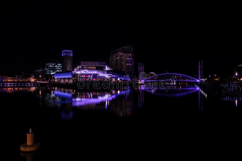 Salford Quays, England, UK, October 9, 2018 A Night time landscape using long exposure of Media City UK showing reflections on th. E Manchester Ship Canal at stock photo