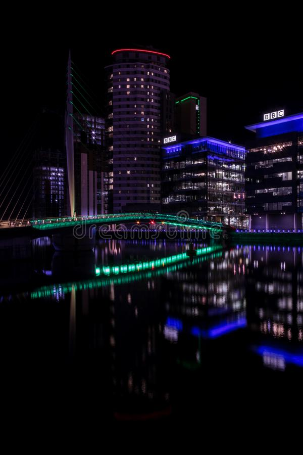 Salford Quays, England, UK, October 9, 2018 A Night time landscape using long exposure of Media City UK showing reflections on th. E Manchester Ship Canal at stock image