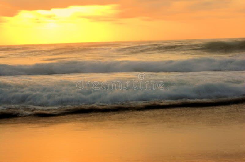 Salida del sol de la playa fotos de archivo libres de regalías