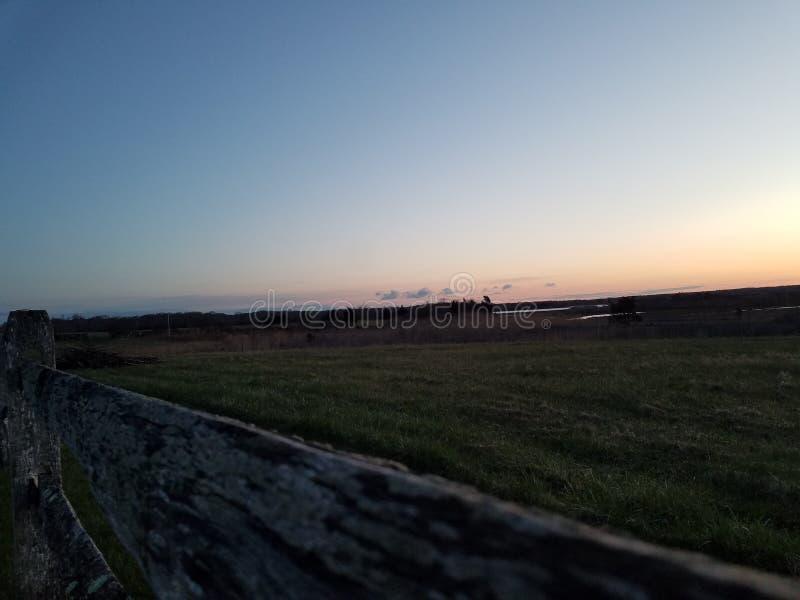 Salida del sol en la granja foto de archivo