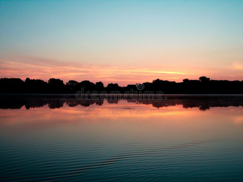 Salida del sol sobre el lago santo name foto de archivo libre de regalías