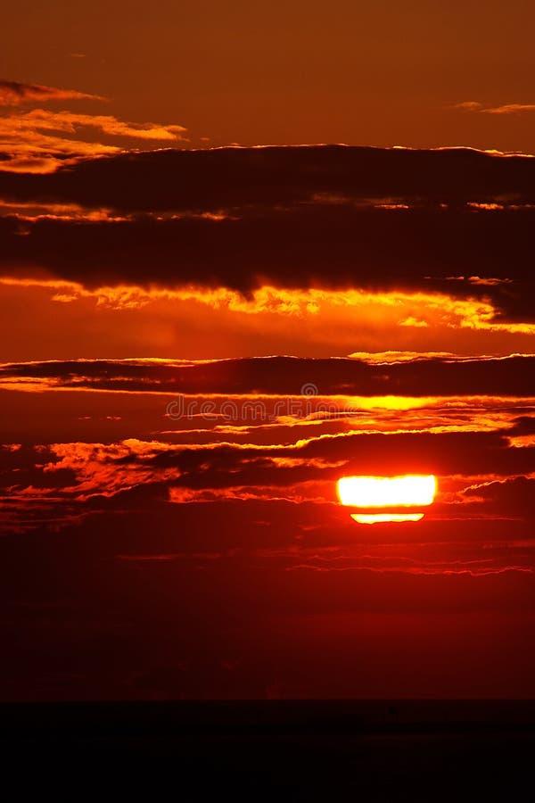 Salidas del sol y puesta del sol imagenes de archivo