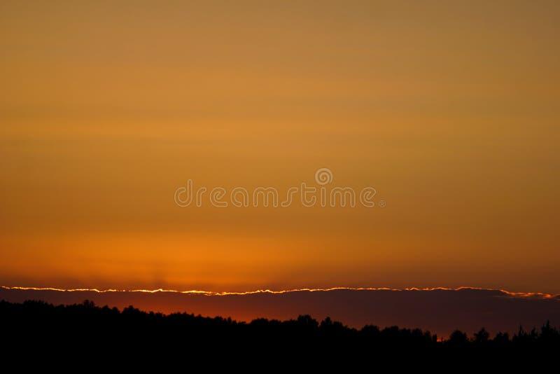 Salidas del sol y puestas del sol foto de archivo