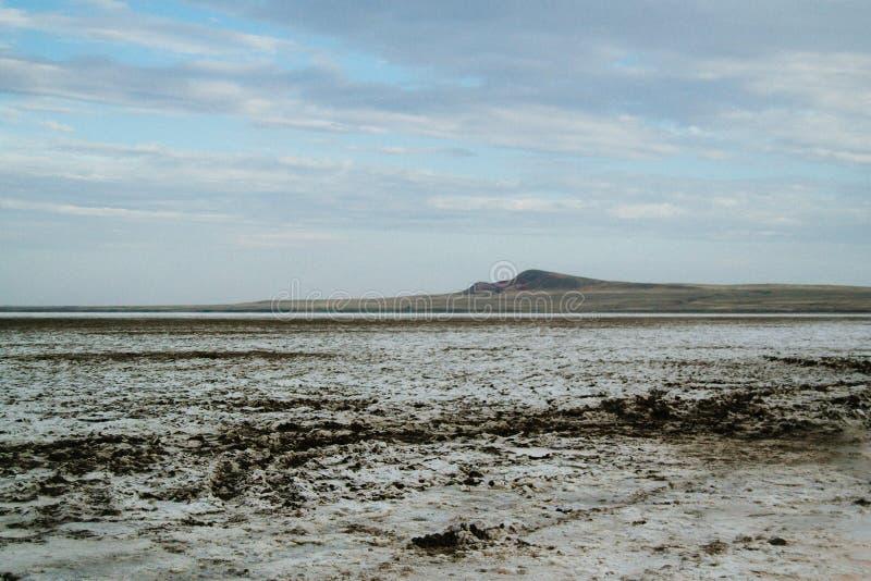 Saline,salt lake Baskunchak. Astrakhan region. Russian landscape. Crystals of natural salt in the lifeless hot terrain on the salt lake Baskunchak. Russia royalty free stock photography