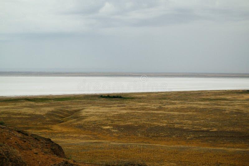 Saline,salt lake Baskunchak. Astrakhan region. Russian landscape. Crystals of natural salt in the lifeless hot terrain on the salt lake Baskunchak. Russia royalty free stock images