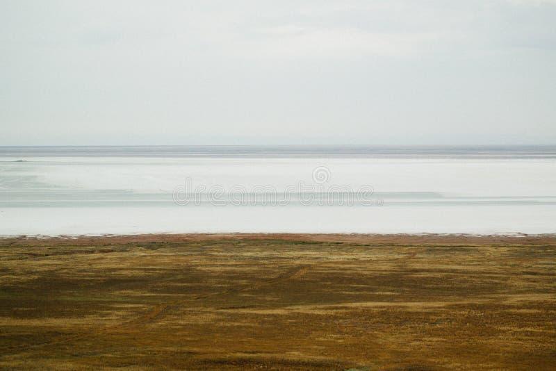 Saline,salt lake Baskunchak. Astrakhan region. Russian landscape. Crystals of natural salt in the lifeless hot terrain on the salt lake Baskunchak. Russia stock photos