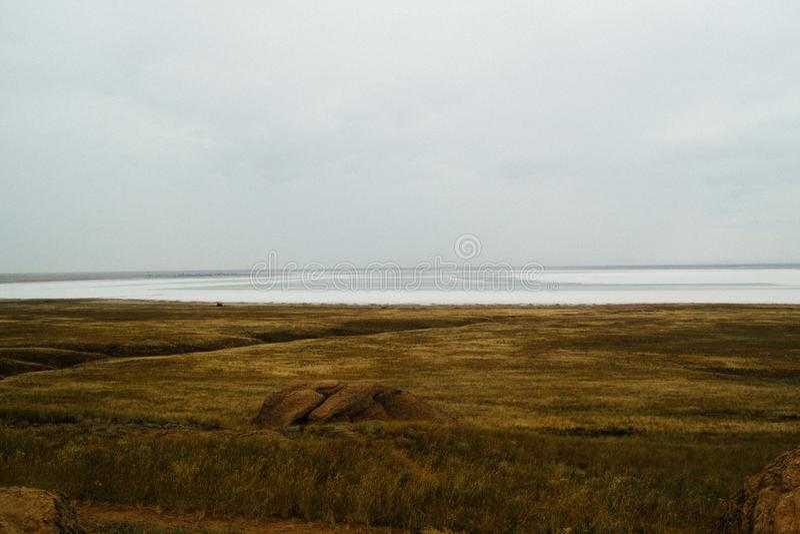 Saline,salt lake Baskunchak. Astrakhan region. Russian landscape. Crystals of natural salt in the lifeless hot terrain on the salt lake Baskunchak. Russia stock photography