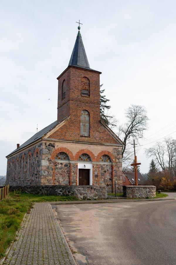 Salino, pomorskie / Poland – November, 21, 2019: Old Catholic church in Pomerania in Central Europe. Catholic temple in a small. Village. Autumn season stock photos