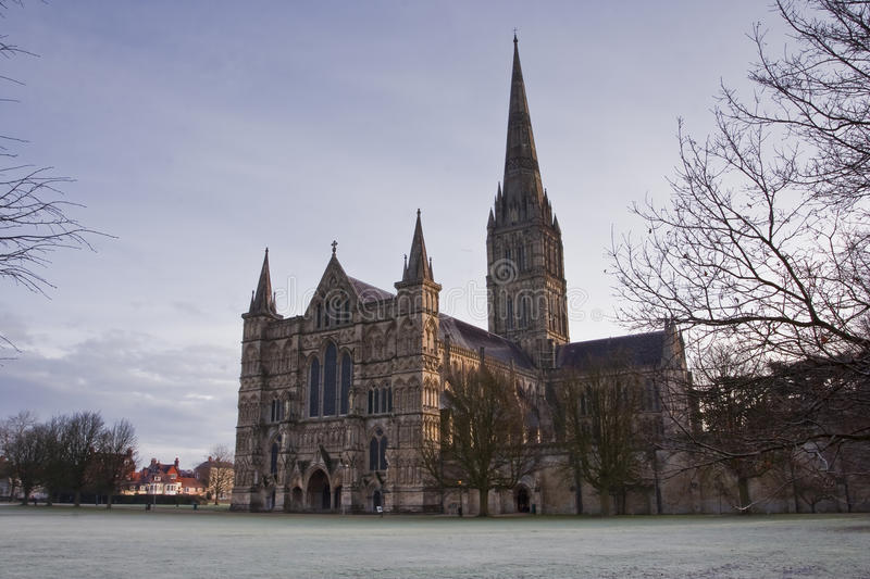 Salisbury cathedral. A frosty start to the day in front of Salisbury cathedral stock photos