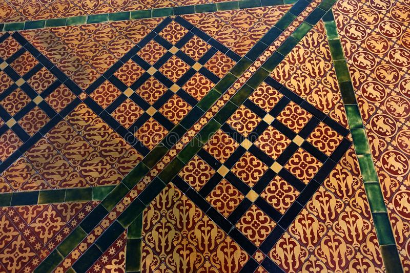 Salisbury Cathedral Chapter House Tile. A complicated yellow, red and green medieval pattern shown in the floor tiling found in Chapter House of Salisbury royalty free stock photos