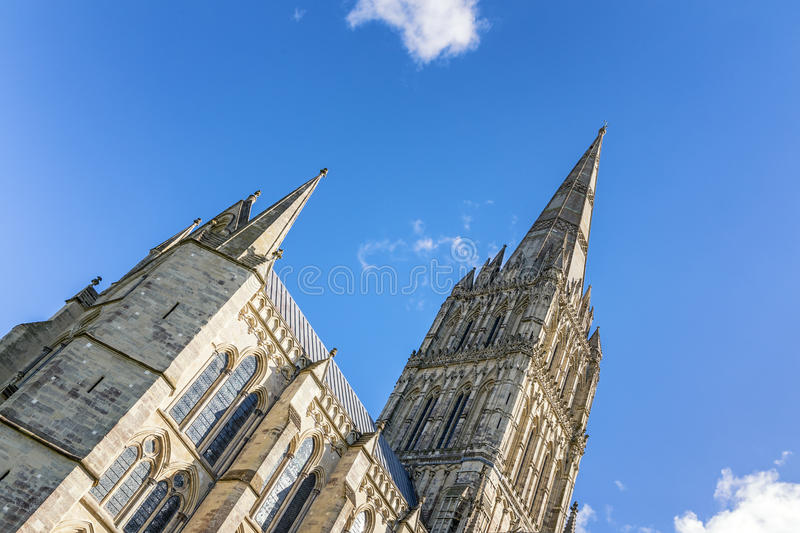 Salisbury Cathedral Spire. The spire of Salisbury Cathedral against blue sky. Built in the 13th century, with the spire completed in the 14th century, this is stock photo