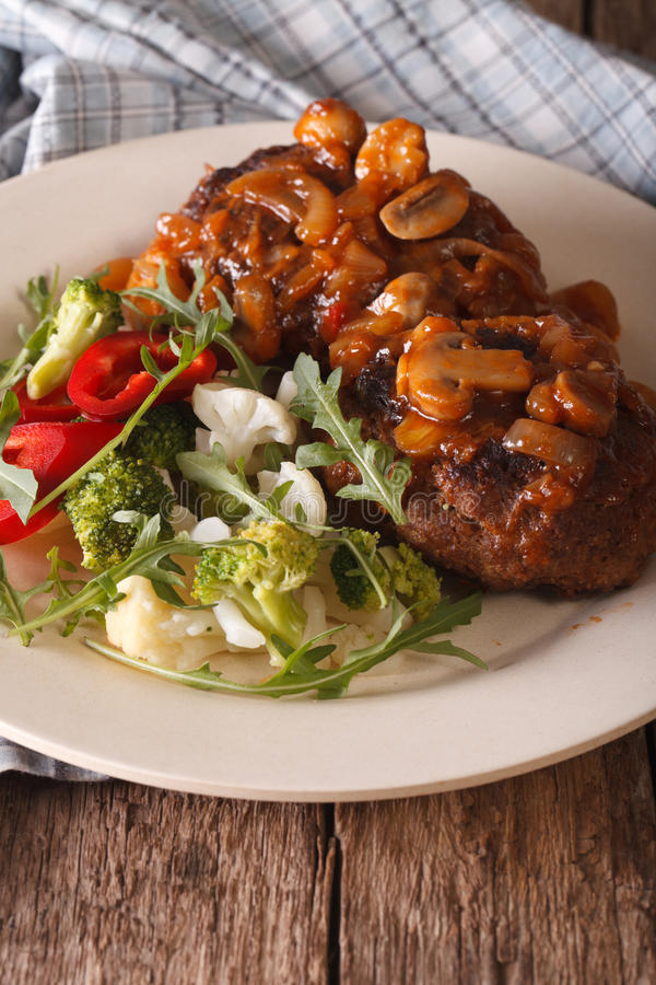 Salisbury steak with mushroom sauce and vegetables close-up. Ver stock photos