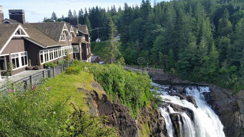 Salish Lodge and Spa Above Snoqualmie Falls. The Salish Lodge and Spa is famous for it`s exterior being used in the hit T.V. show Twin Peaks, it`s breathtaking royalty free stock images