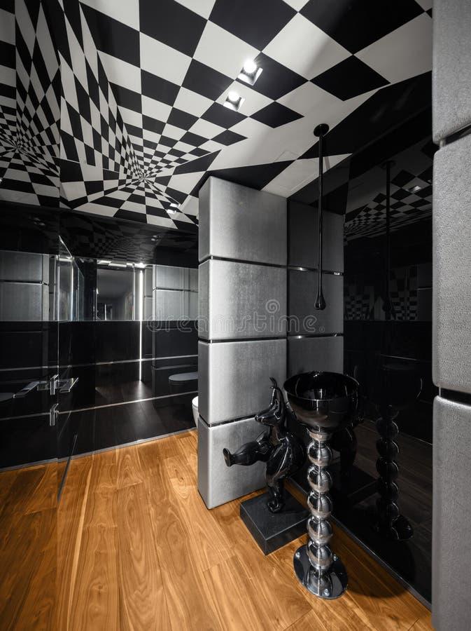 Salle de bains moderne avec la décoration noire et blanche, personne photo stock