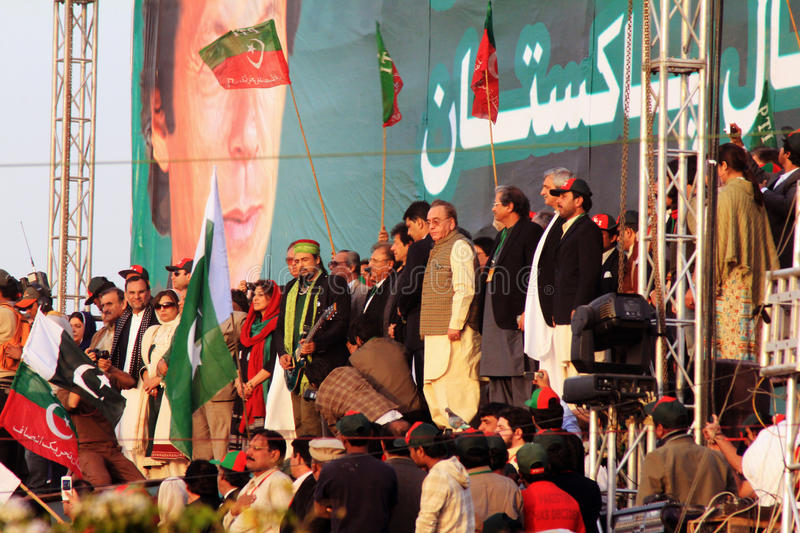Salman Ahmed plays National Anthem at PTI Rally. Former Junoon Guitarist Salman Ahmed plays the Pakistani National Anthem at a rally organized by Former stock images