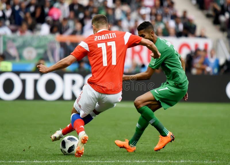 Salman Alfaraj against Russian midfielder Roman Zobnin. Moscow, Russia - June 14, 2018. Saudi Arabian midfielder Salman Alfaraj against Russian midfielder Roman royalty free stock images
