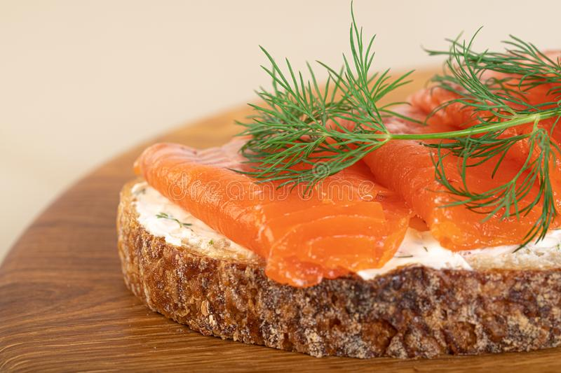 Salmom sandwich. Sandwich with salmon on wooden board stock images