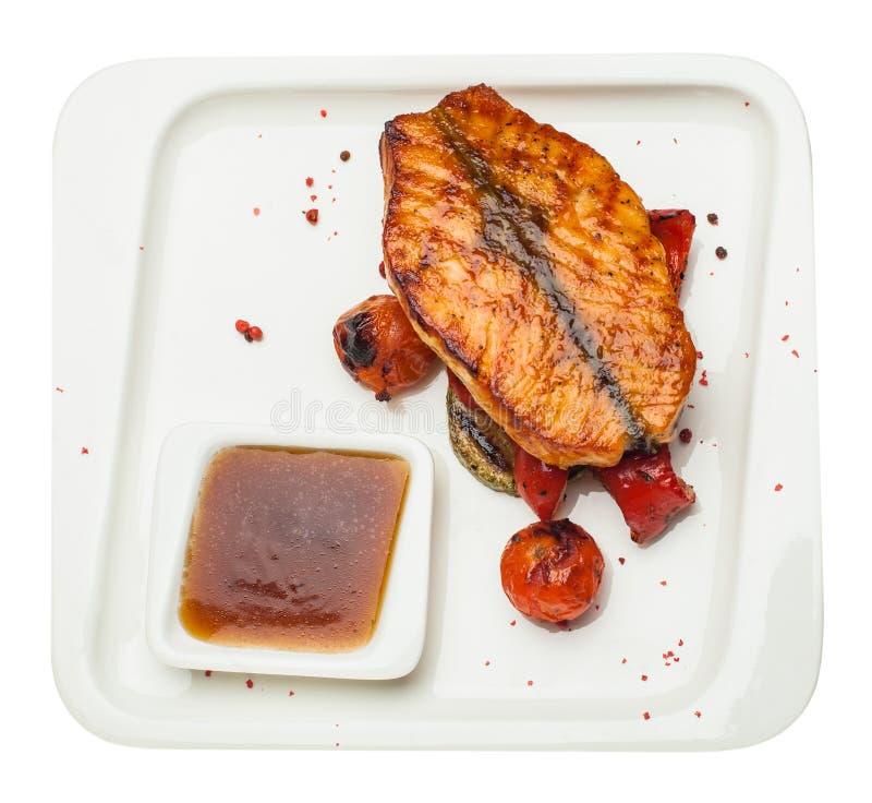 Salmon стейк изолированный на белой предпосылке, взгляд сверху стоковые фотографии rf