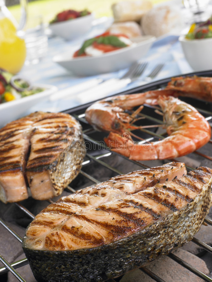 Free Salmon And Prawns Cooking On A Grill Stock Photos - 8755403