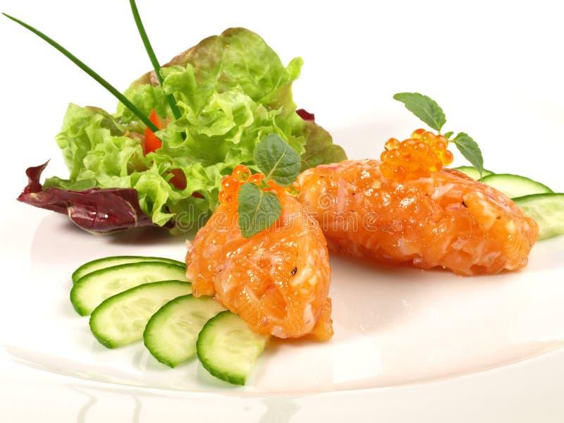 Salmon Appetizer - Vissentandsteen stock afbeelding