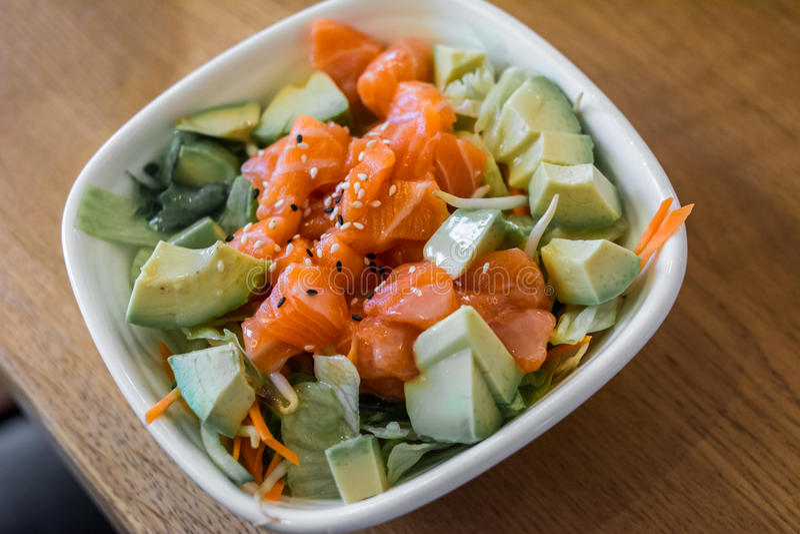 Salmon avocado salad stock images