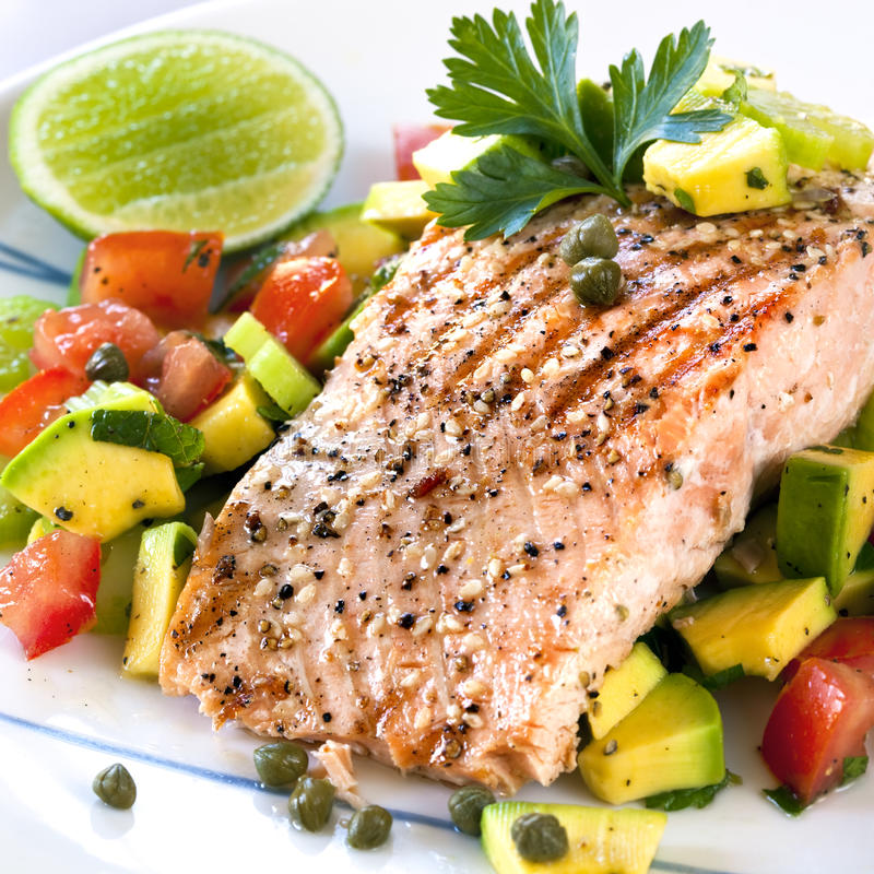 Salmon with Avocado Salsa royalty free stock images